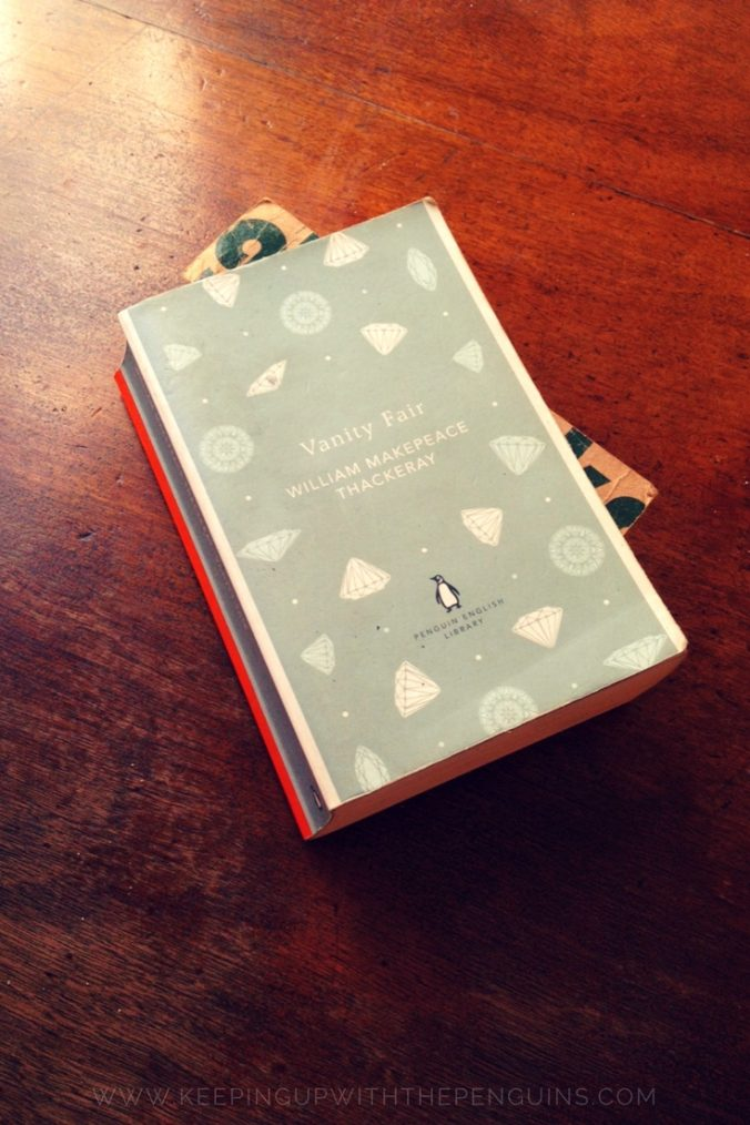 Vanity Fair - William Makepeace Thackeray - book laid on wooden table - Keeping Up With The Penguins