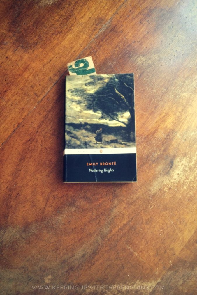 Wuthering Heights - Emily Bronte - book laid on wooden table - Keeping Up With The Penguins