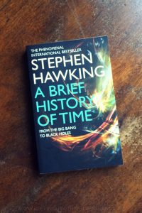 A Brief History of Time - Stephen Hawking - Book laid on a wooden table - Keeping Up With The Penguins