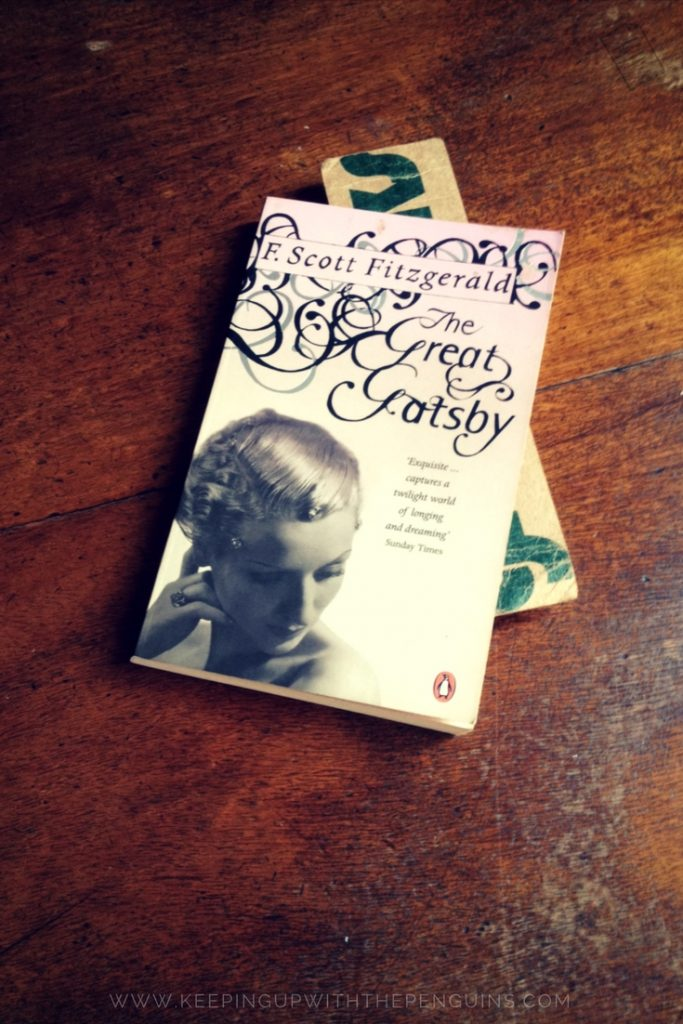 The Great Gatsby - F Scott Fitzgerald - book laid on wooden table - Keeping Up With The Penguins