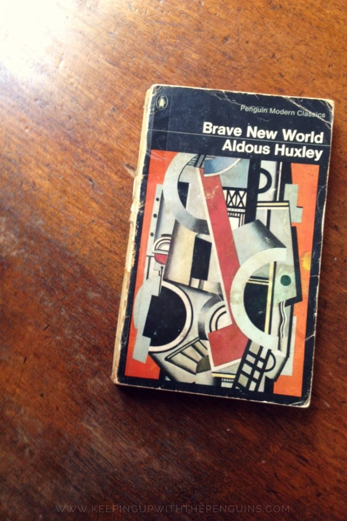 Brave New World - Aldous Huxley - book laid on a wooden table - Keeping Up With The Penguins