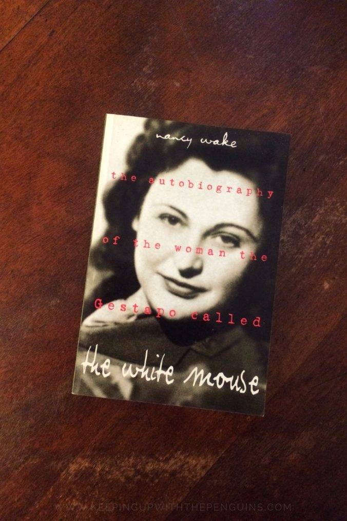 The White Mouse Nancy Wake Book Laid Flat on Wooden Table Keeping Up With The Penguins