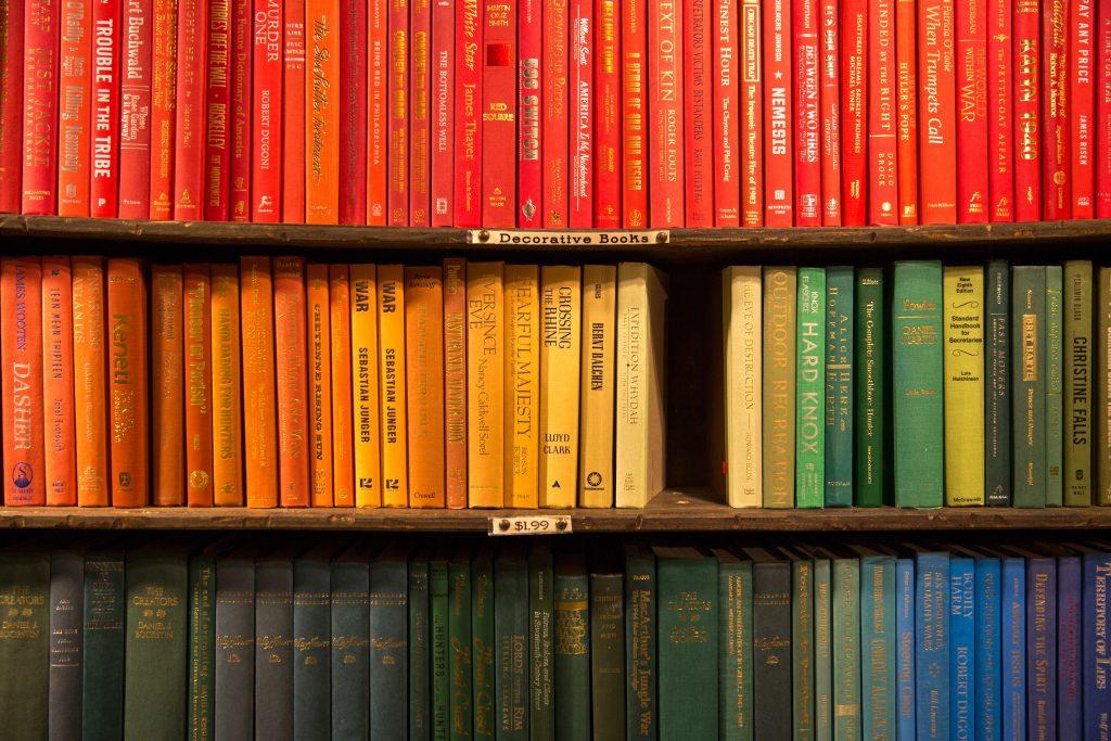 Bookshelves Arranged by Colour in a Rainbow